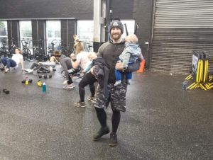 One of our Mum & Baby coaches holding a couple of little'uns - even the coaches get a workout.